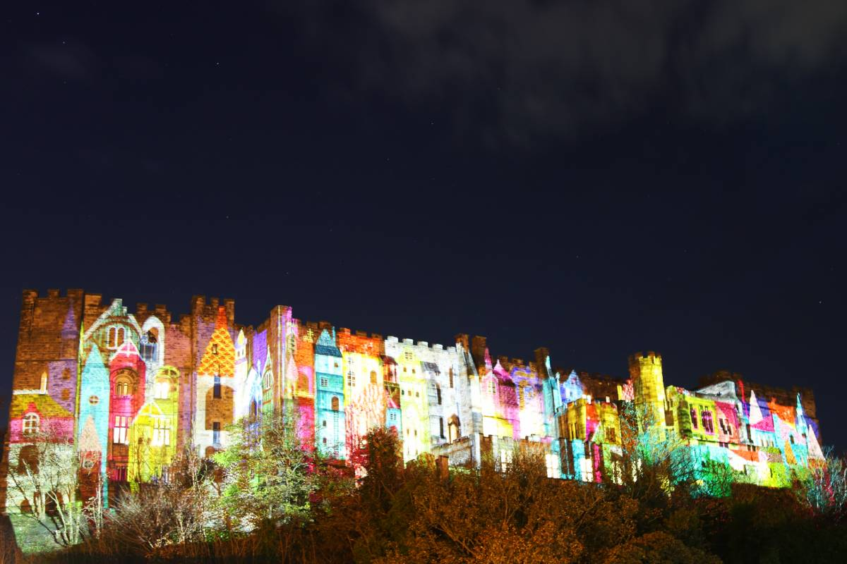Durham Lumiere pictures: Fool's Paradise is projected on to the side of Durham Castle