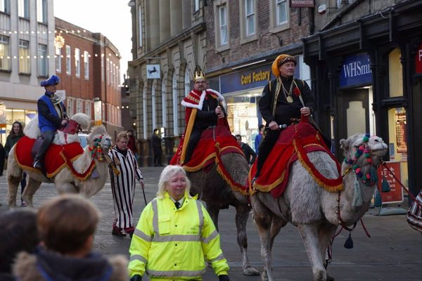 Real camels walk through Durham Marketplace during Live Nativity